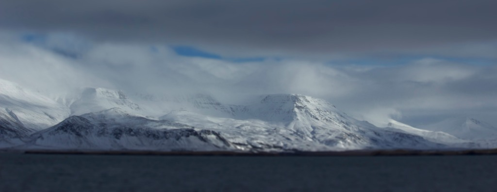 As seen across the Northern Atlantic, Reykjavik. Faux tilt-shift added in PS